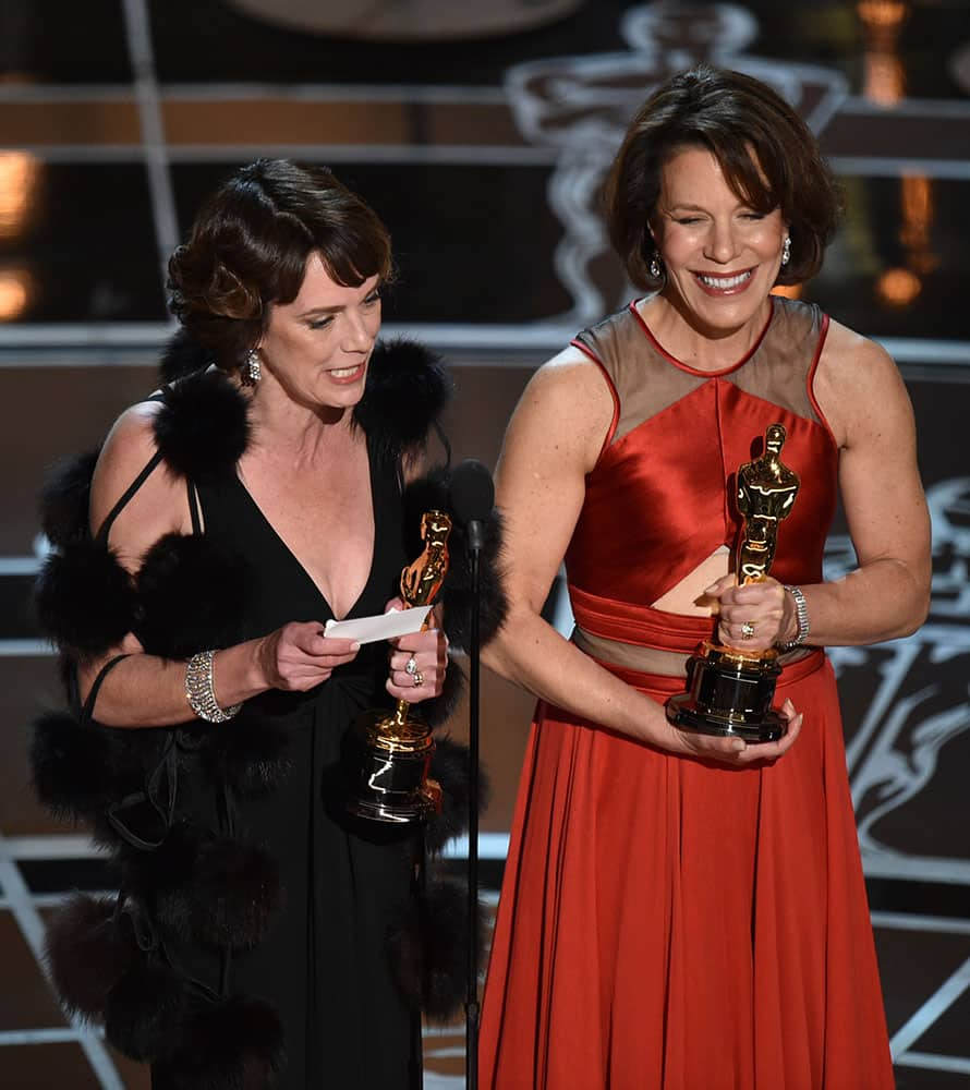 """Dana Perry, left, and Ellen Goosenberg Kent accept the award for best short subject documentary for """"Crisis Hotline: Veterans Press 1"""" at the Oscars, at the Dolby Theatre in Los Angeles."""
