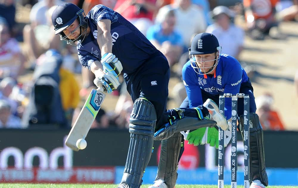 Scotland's Matt Cross hits the ball as England wicketkeeper Jos Buttler watches during their Cricket World Cup match in Christchurch, New Zealand.