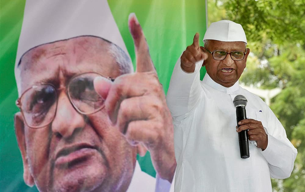 Social activist Anna Hazare addresses his supporters on the first day of his two-day agitation against the ordinance on Land Acquisition Bill at Jantar Mantar in New Delhi.