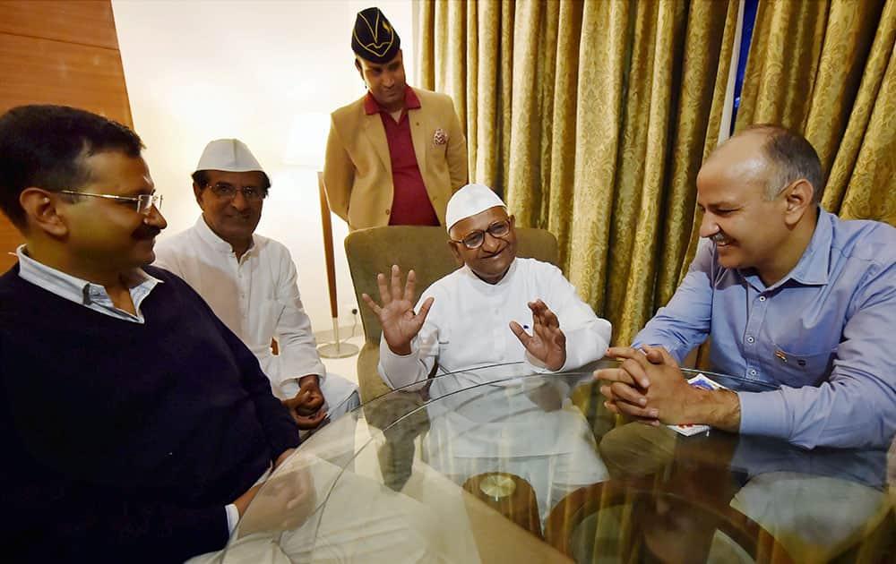 Social activist Anna Hazare with Delhi Chief Minister Arvind Kejriwal and his deputy Manish Sisodia at a meeting at Maharashtra Sadan in New Delhi.