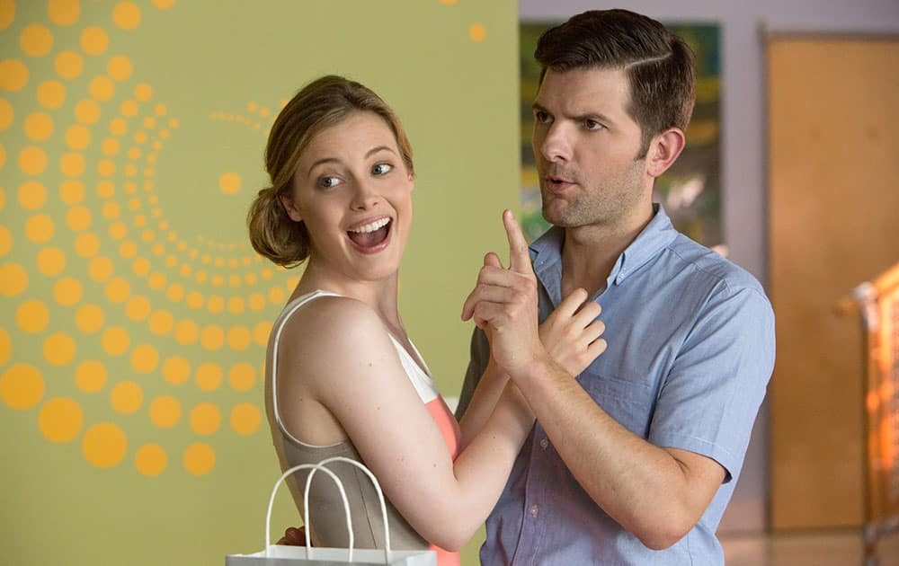 Gillian Jacobs and Adam Scott appear in a scene from