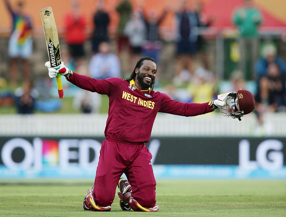 West Indies batsman Chris Gayle celebrates after scoring a double century during their Cricket World Cup Pool B match against Zimbabwe in Canberra, Australia.