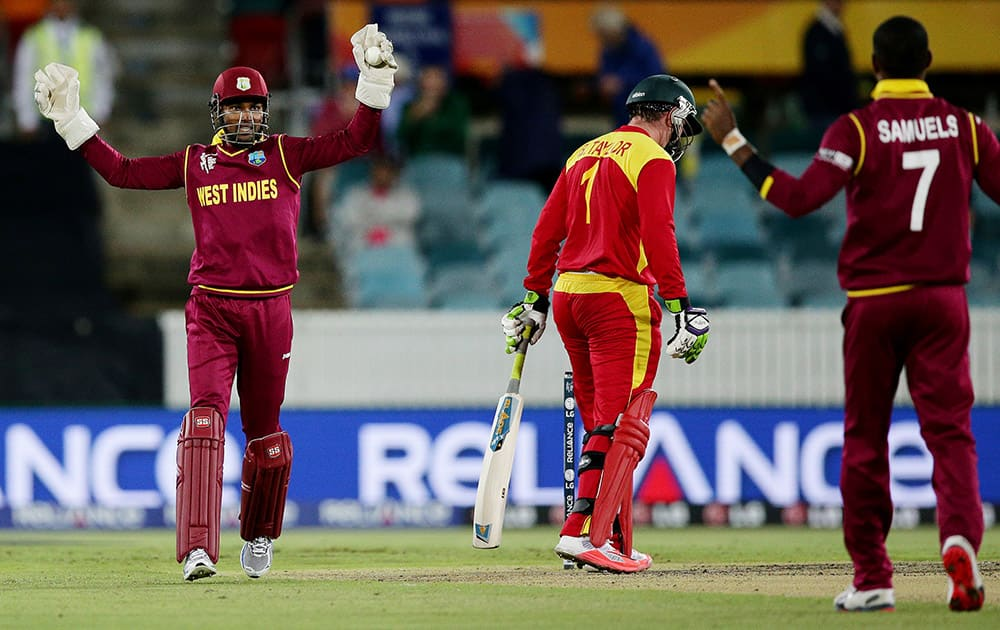 West Indies wicketkeeper Denesh Ramdin appeals successfully for a catch to dismiss Zimbabwe batsman Brendan Taylor for 37 runs off the bowling of teammate Marlon Samuels during their Cricket World Cup Pool B match in Canberra, Australia.