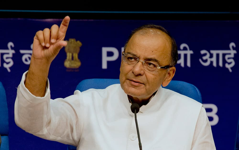 Finance Minister Arun Jaitley addresses a press conference after the 14th Finance Commission report was tabled in the Lok Sabha, in New Delhi.