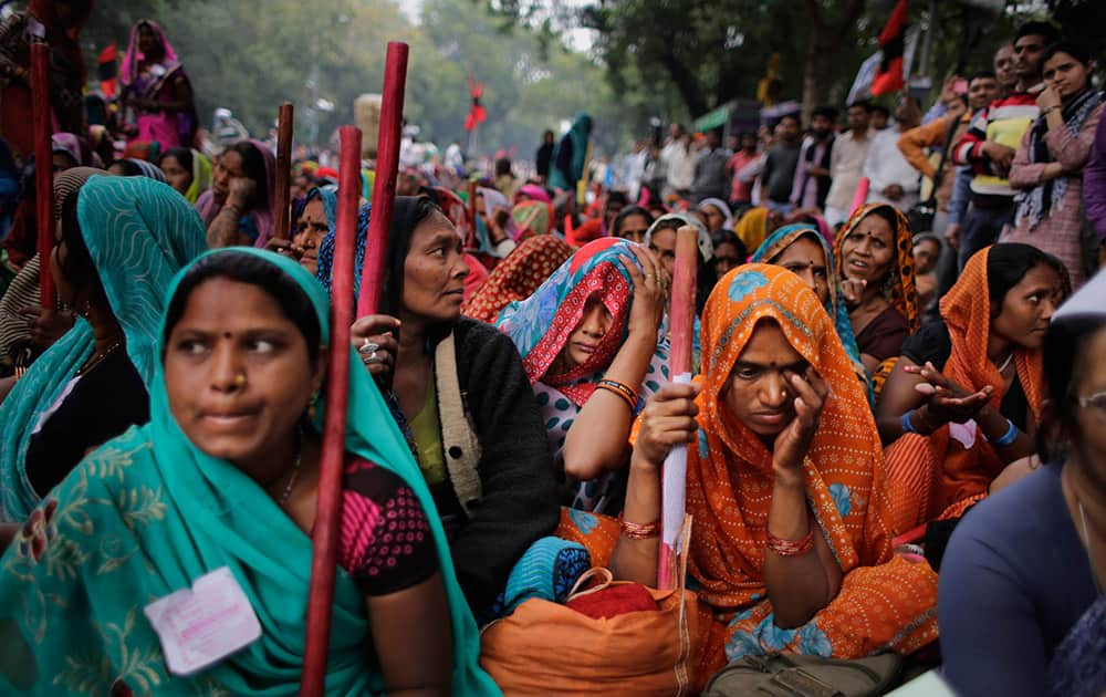 Farmers gather for a protest against the government's proposed move to ease rules for acquiring land to facilitate infrastructure projects in New Delhi.