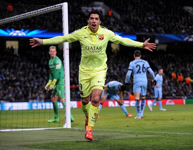 Barcelona's Luis Suarez celebrates after scoring his second goal against Manchester City during the Champions League round 16 match between Manchester City and Barcelona at the Etihad Stadium, in Manchester, England.