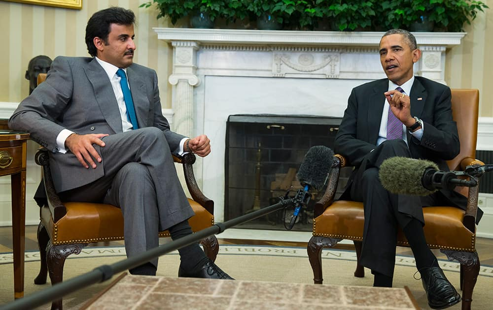 President Barack Obama meets with the Emir of Qatar Sheikh Tamim bin Hamad al Thani, in the Oval Office of the White House in Washington.