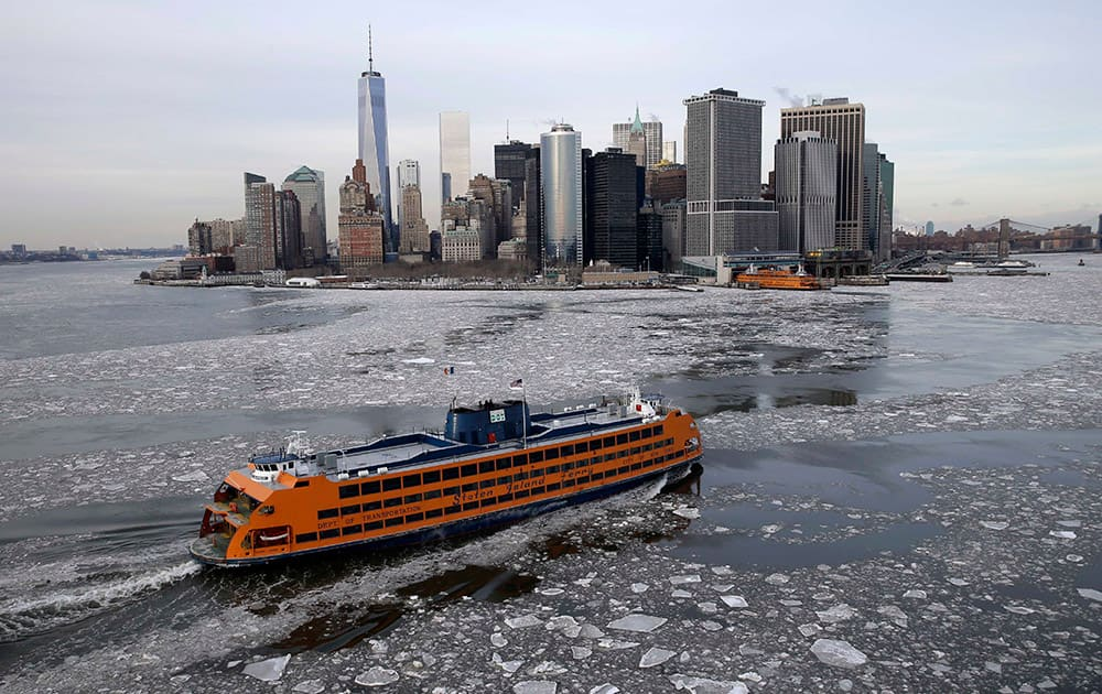 A ferry makes its way through ice in New York. The Weather Service said temperatures would be 15 to 25 degrees below average for most of the East Coast west to the Great Lakes and lower Mississippi River Valley.