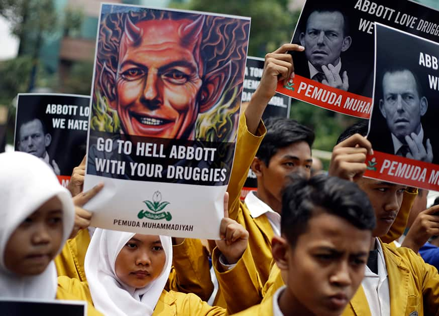 Indonesian Muslim students hold up posters during a protest against Australian Prime Minister Tony Abbott outside the Australian Embassy in Jakarta, Indonesia.