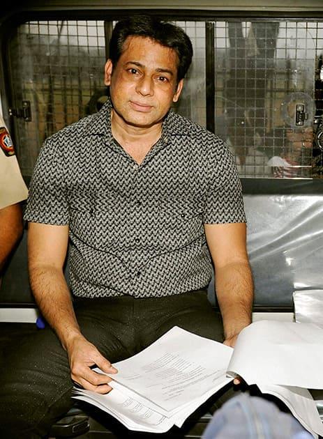 Gangster Abu Salem is taken to jail after a Mumbai court on Wednesday sentenced him life imprisonment in Pradeep Jain murder case.