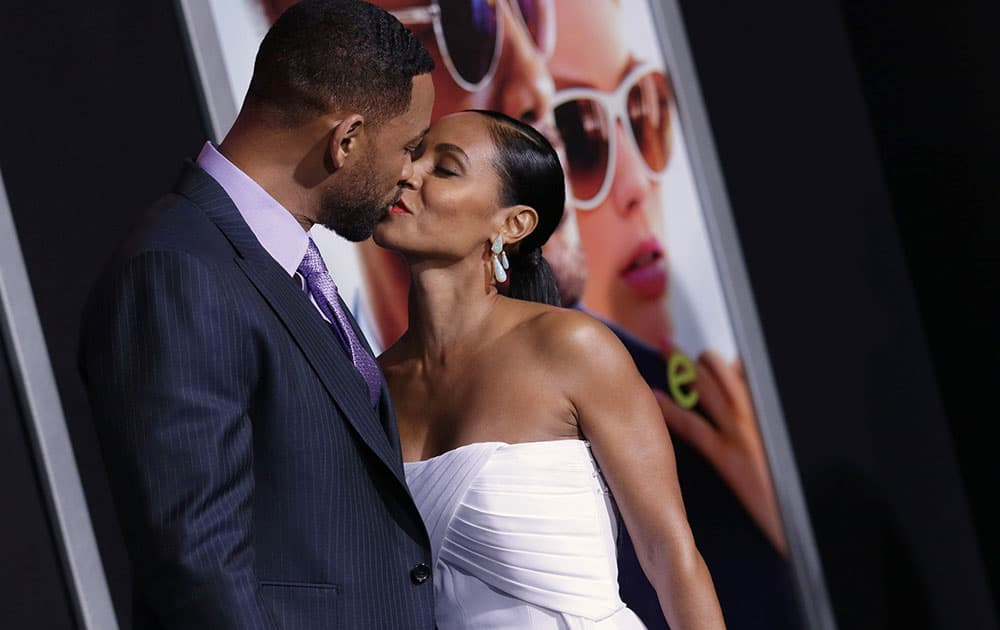 Will Smith, left, and Jada Pinkett Smith arrive at the world premiere of