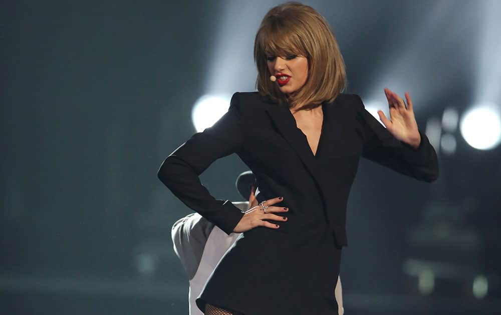 Taylor Swift performs onstage at the Brit Awards 2015 at the 02 Arena in London.