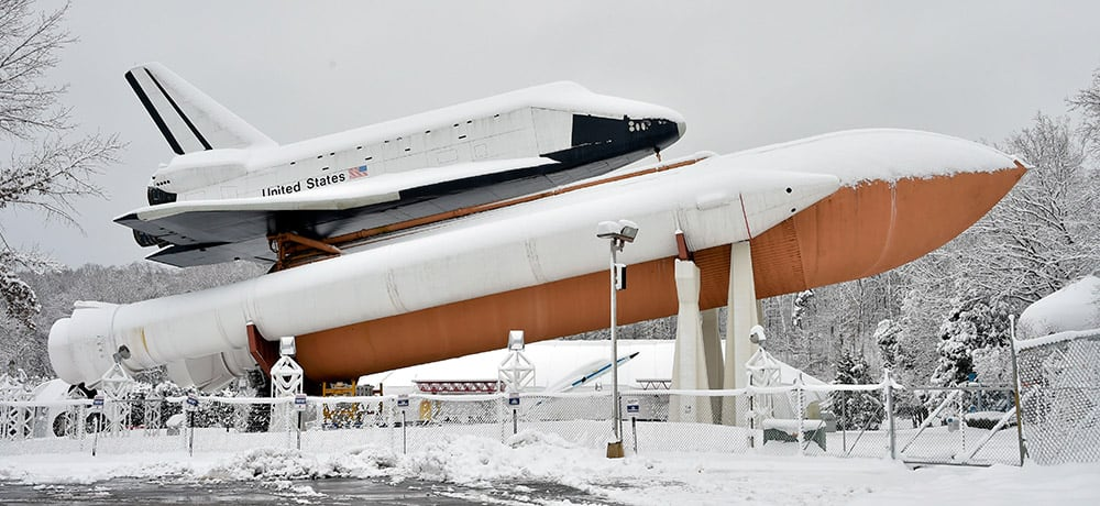 Snow covers the Space Shuttle Pathfinder display at the US Space & Rocket Center, in Huntsville, Ala.