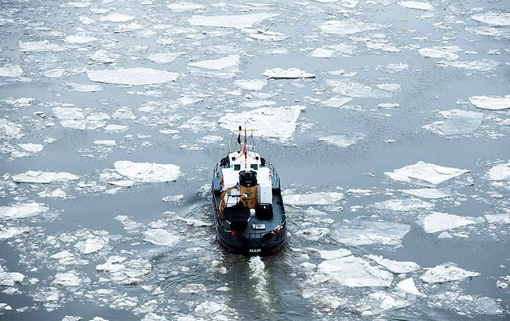 The U.S. Coast Guard Cutter Cleat operates in the Delaware River as part of its winter ice breaking mission.