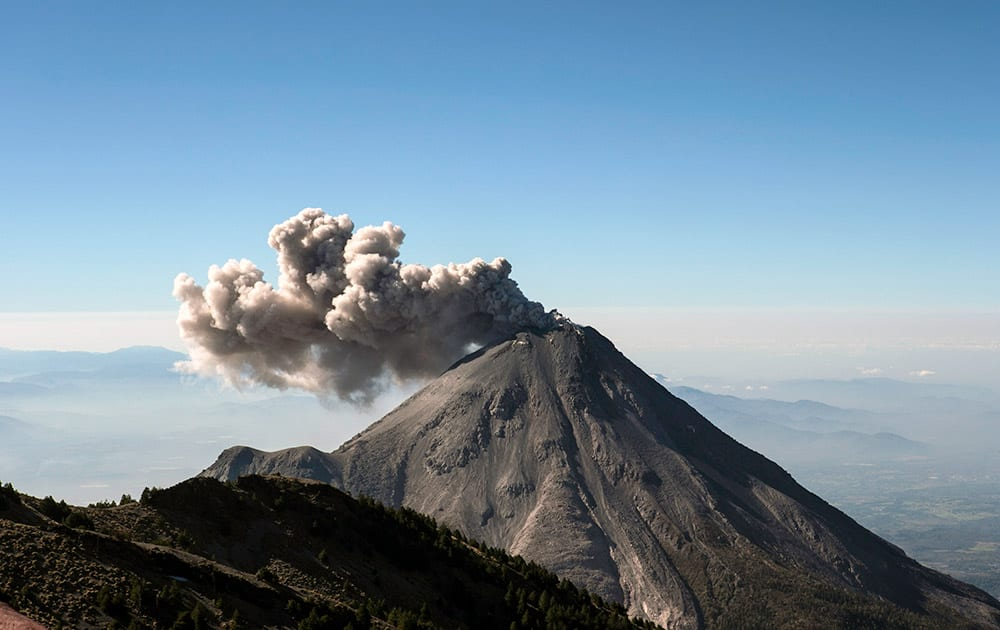 A large cloud of ash and steam rises from the crater of the Colima Volcano as seen from the civil protection observatory near Ciudad Guzman, Mexico.