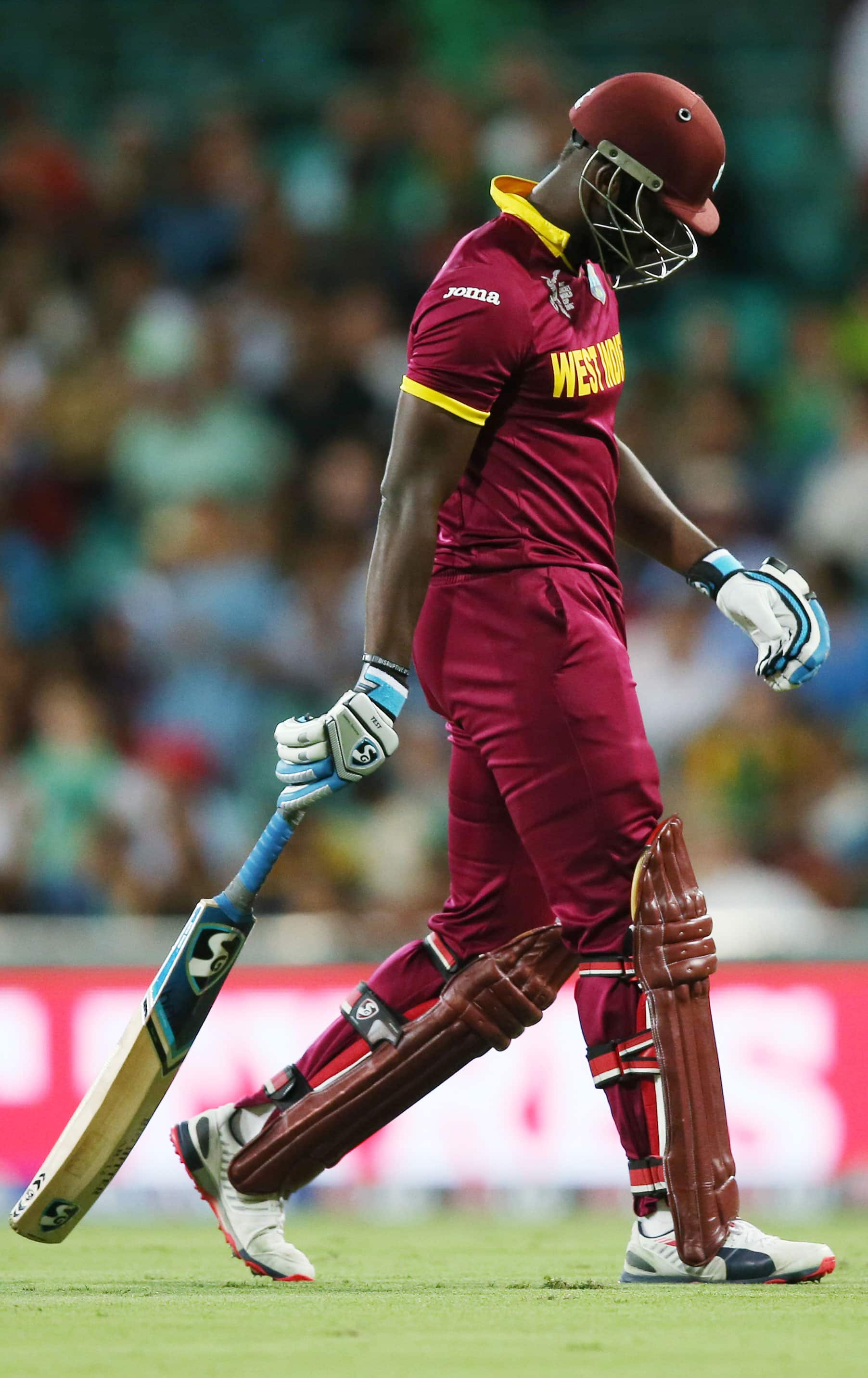 West Indies batsman Andre Russell walks from the field after he was dismissed for no score during their Cricket World Cup Pool B match against South Africa in Sydney.