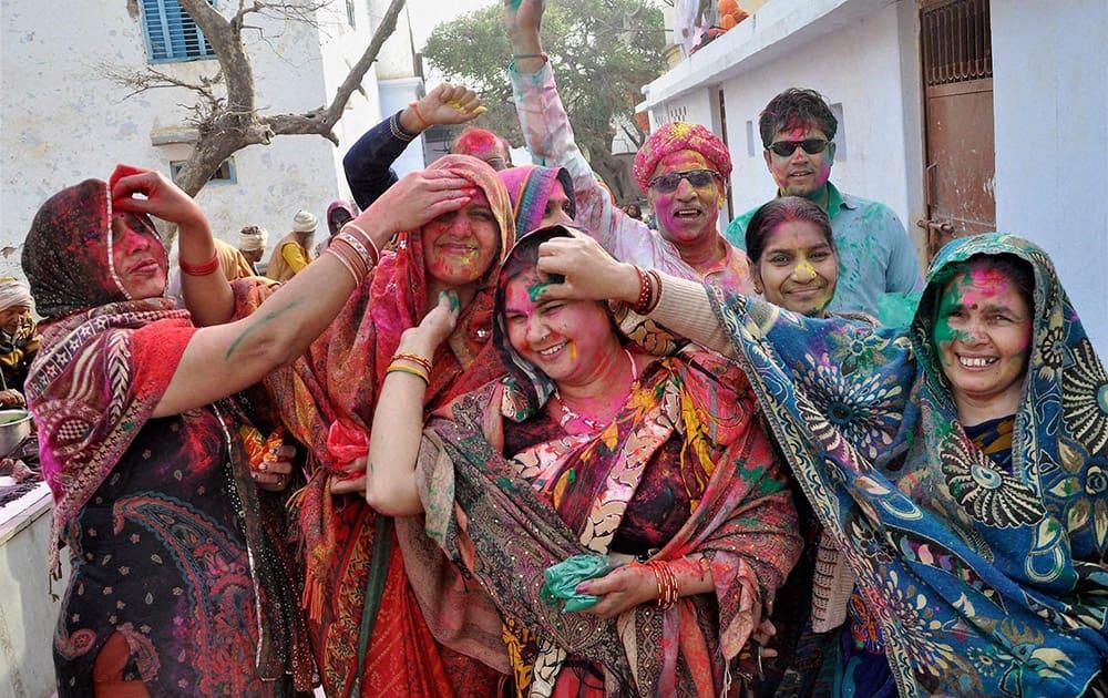 Devotees during Holi celebration in Barsana near Mathura .