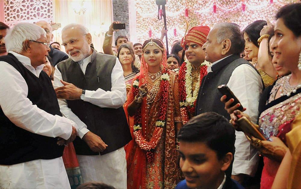 Prime Minister Narendra Modi at the wedding ceremony of Tej Pratap Singh Yadav, grand-nephew of SP chief Mulayam Singh Yadav and Raj Laxmi, daughter of Lalu Prasad, in New Delhi.