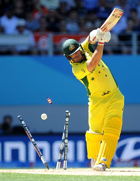 Australian batsman Aaron Finch is bowled during their Cricket World Cup match against New Zealand in Auckland.