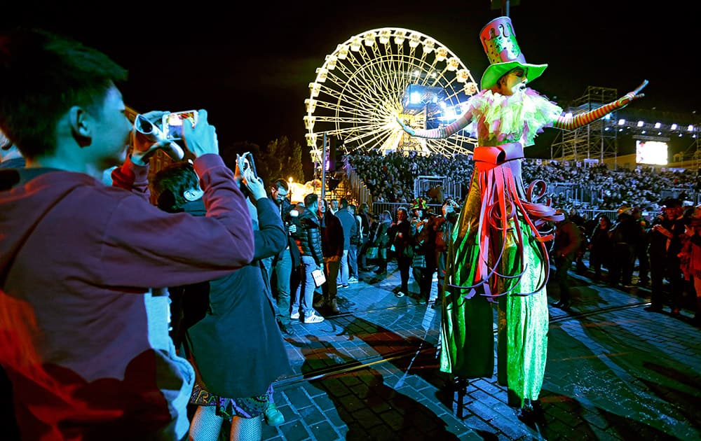 Revelers parade during France's first gay carnival, 'Lou Queernaval', in Nice, southeastern France.