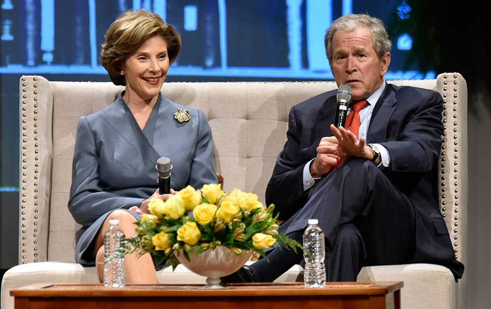 Former President George W. Bush and his wife Laura speak during a Fireside Chat, at Christ's Church in Jacksonville, Fla.