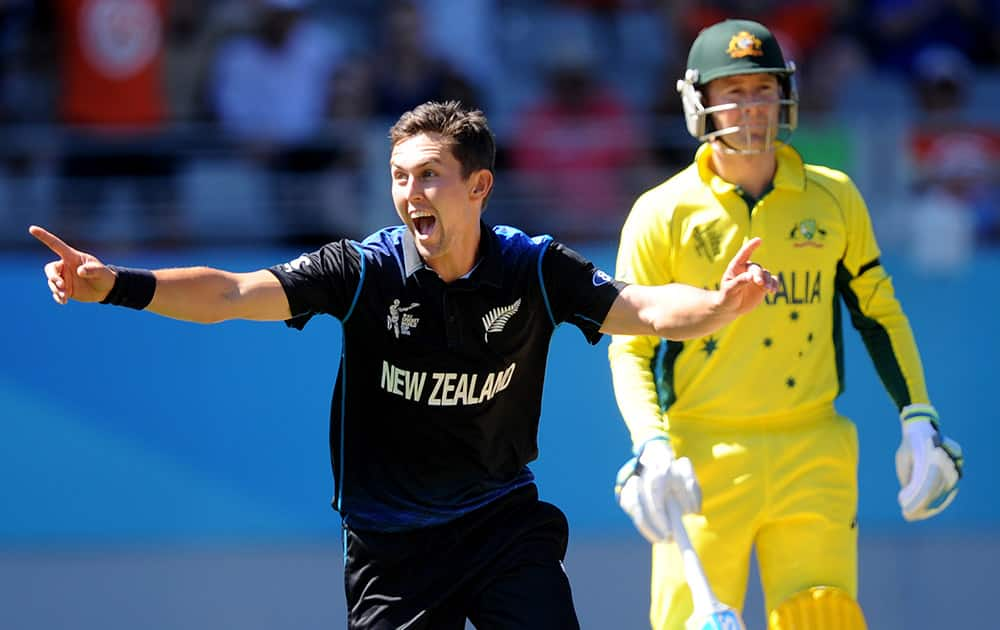 New Zealand's Trent Boult celebrates after taking the wicket of Australia's Australia's Mitchell Marsh during their Cricket World Cup match in Auckland, New Zealand