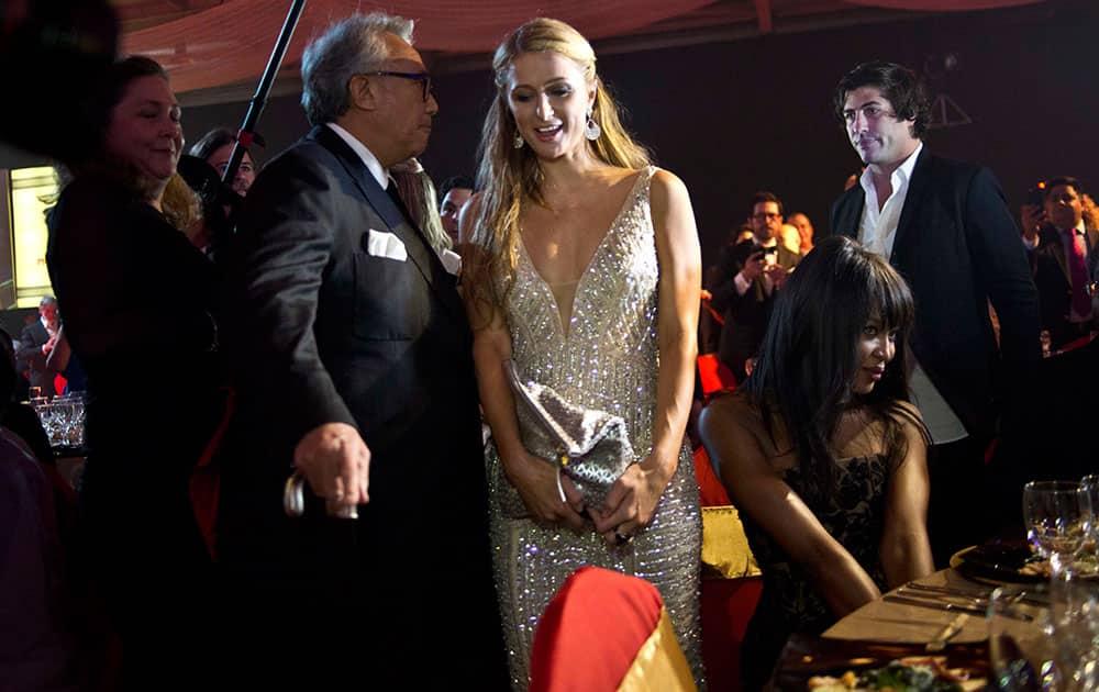 Celebrity Paris Hilton, center, arrives to the gala dinner of the 17th Cigar Festival in Havana, Cuba.