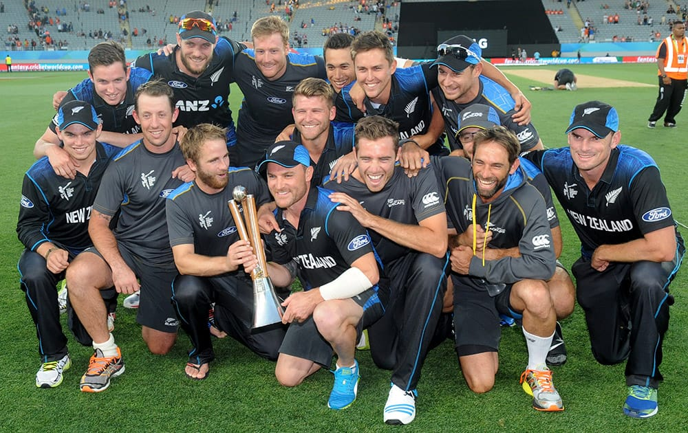 New Zealand team pose with the Chappell Hadlee after defeating Australia in their Cricket World Cup match in Auckland.