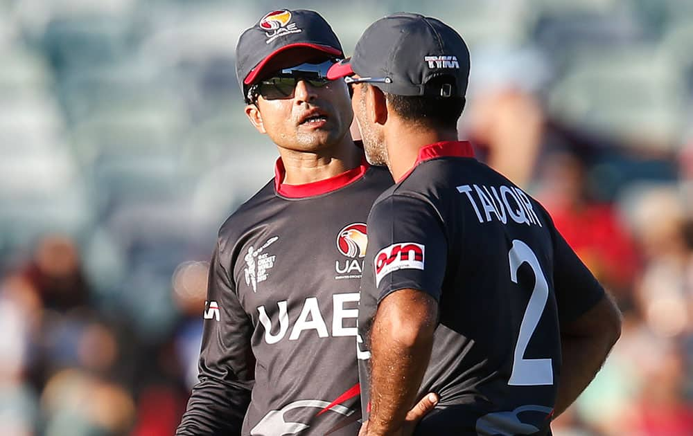 United Arab Emirates Shaiman Anwar left, speaks to Mohamed Tauqir during their Cricket World Cup Pool B match against India in Perth, Australia.