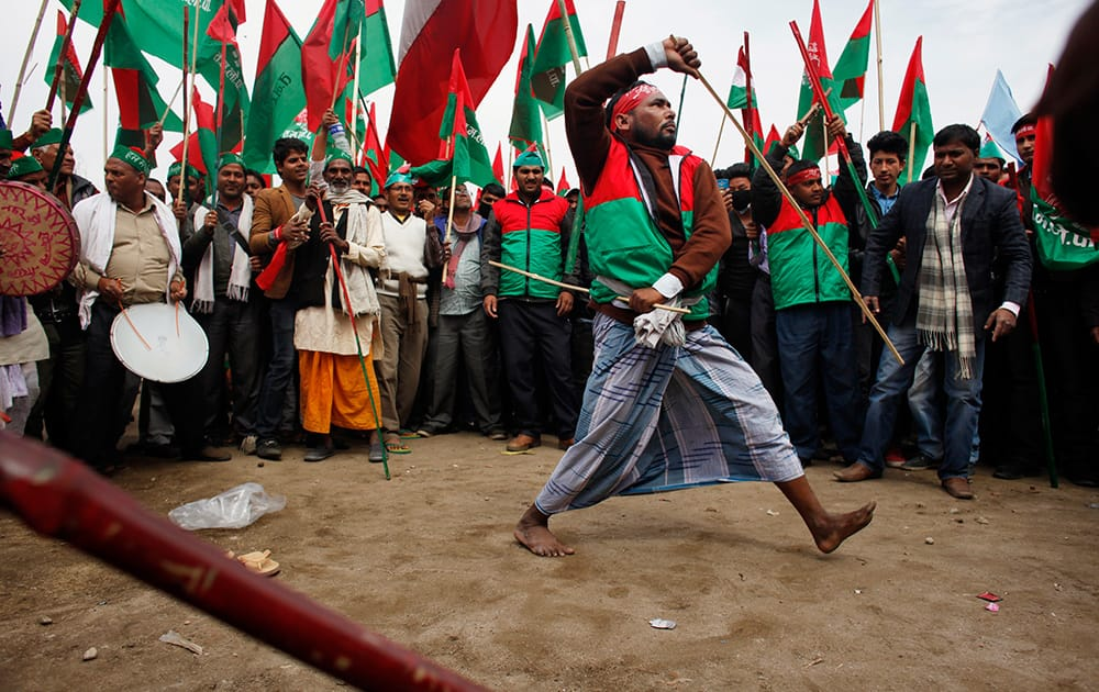 A Nepalese supporter of alliance of 30 opposition parties dances during a protest led by Unified Communist Party of Nepal-Maoist in Kathmandu, Nepal.