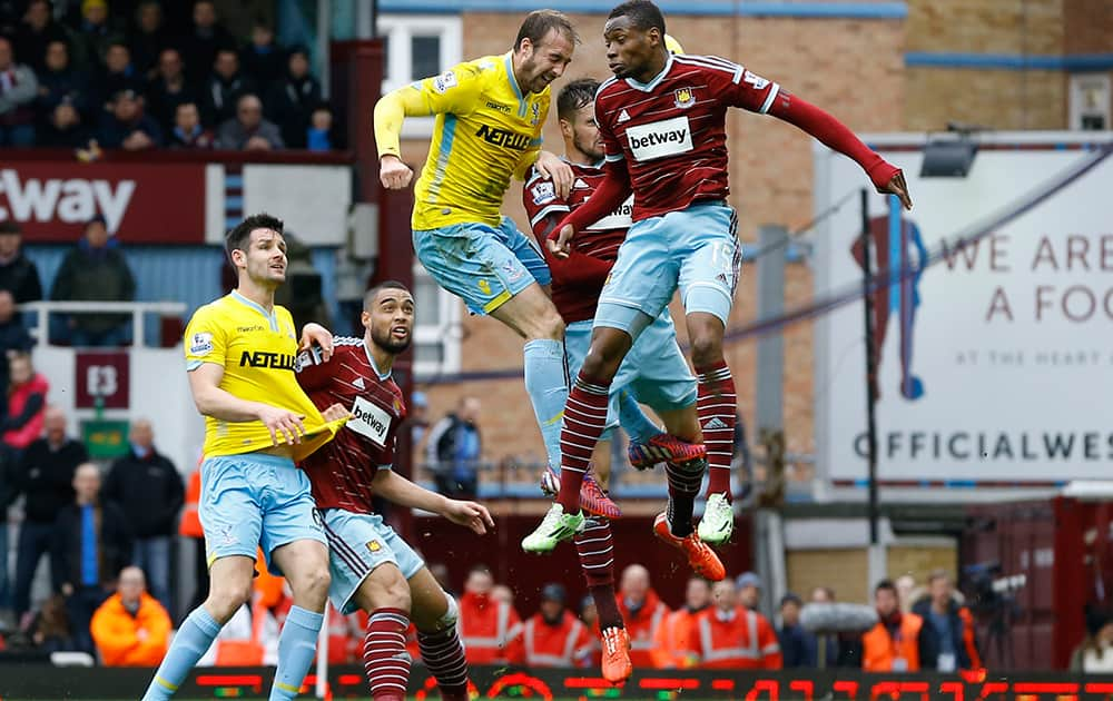 Crystal Palace's Glenn Murray heads in a goal during the English Premier League soccer match between West Ham United and Crystal Palace at the Boleyn Ground in London.