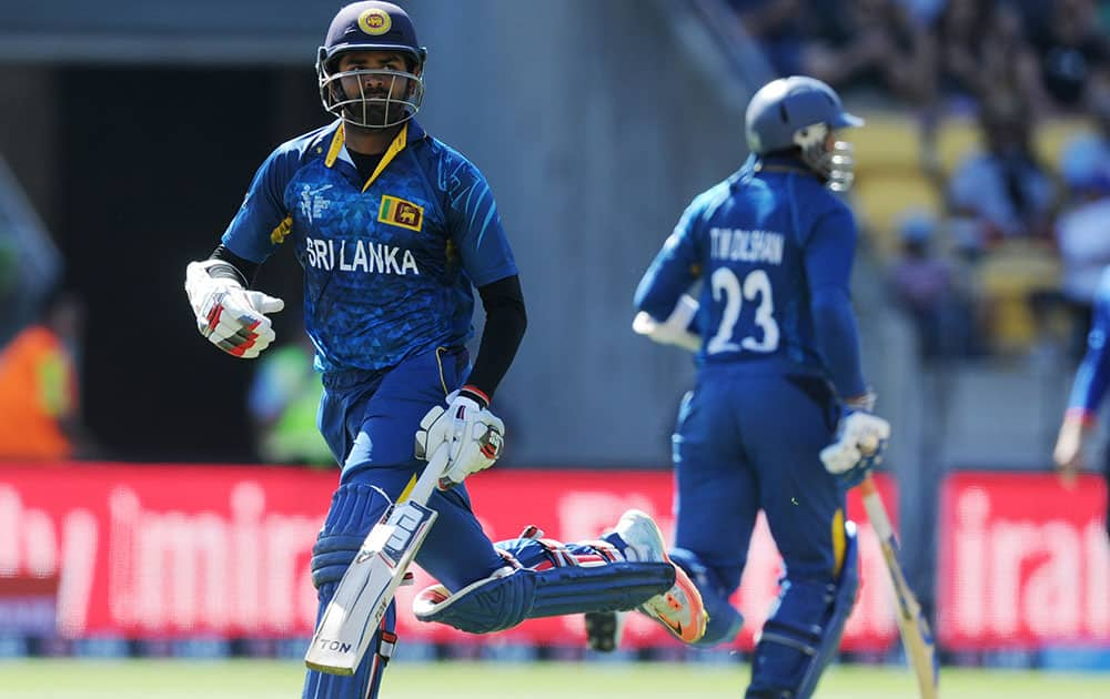 Sri Lanka's Lahiru Thirimanne, left, runs with batting partner Sri Lanka's Tillakaratne Dilshan during their Cricket World Cup match against England in Wellington, New Zealand.
