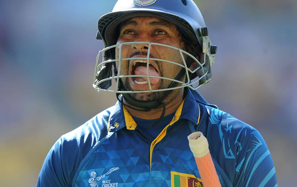 Sri Lanka's Tillakaratne Dilshan reacts as he leaves the field after he was dismissed for 44 runs during their Cricket World Cup match against England in Wellington, New Zealand.