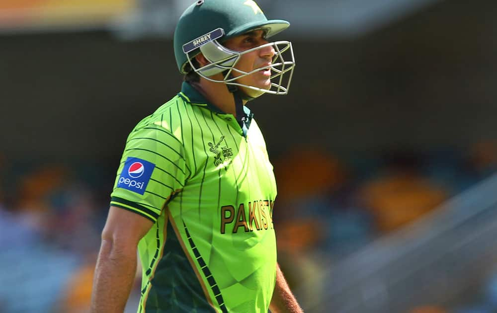 Pakistan's Nasir Jamshed walks after his dismissal during the Pool B Cricket World Cup match between Pakistan and Zimbabwe in Brisbane, Australia.