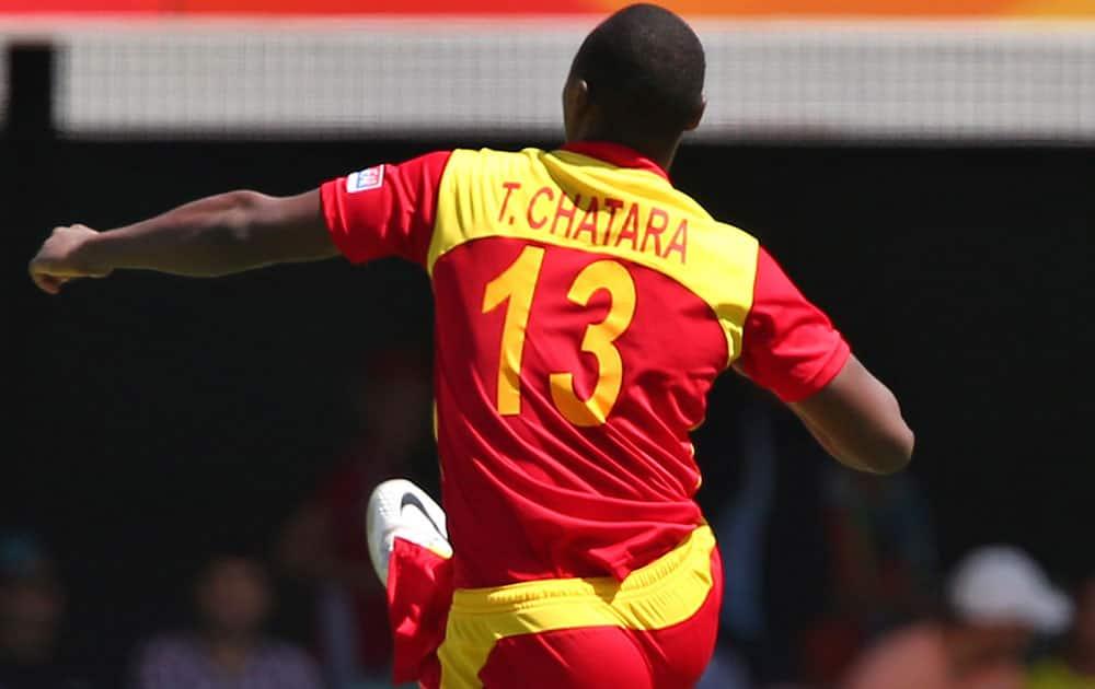 Zimbabwean Tendai Chatara celebrates the wicket of Pakistan's Ahmed Shehzad during the Pool B Cricket World Cup match in Brisbane, Australia.