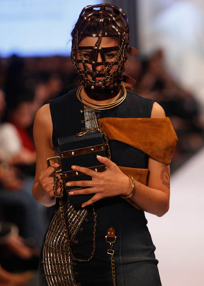 A model presents creations by Pakistan Institute of Fashion and Design at Expo Pakistan Fashion Show.