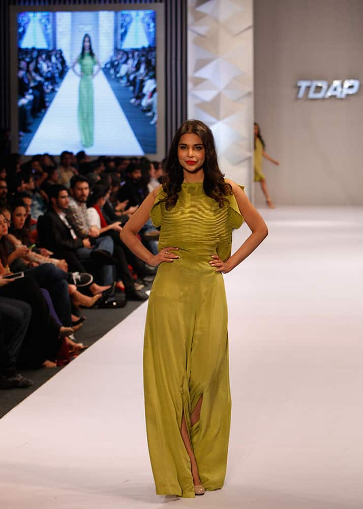 A model presents creations by Pakistani designer Sadaf Malaterre at Expo Pakistan Fashion Show.