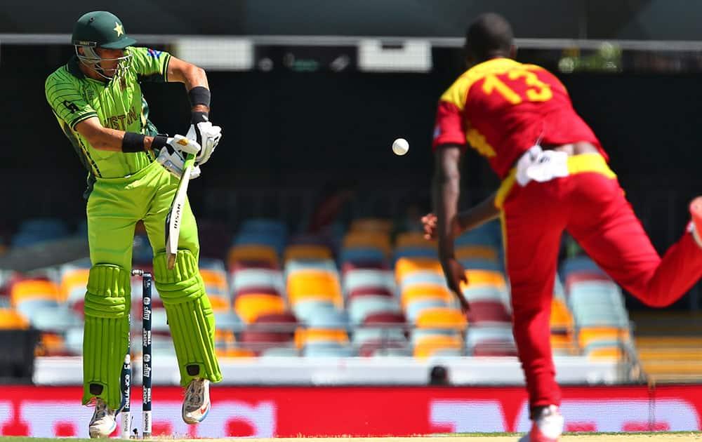 Pakistan's Misbah ul-Haq plays a shot off Zimbabwean Tendai Chatara during the Pool B Cricket World Cup match in Brisbane, Australia.