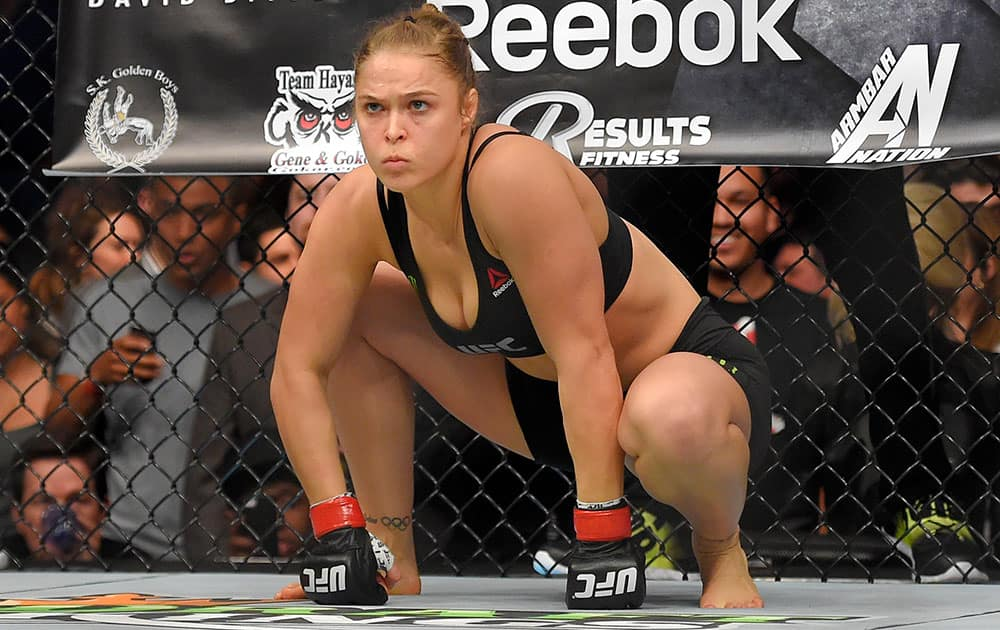 Ronda Rousey gets ready to fight Cat Zingano in a UFC 184 mixed martial arts bantamweight title bout, in Los Angeles. Rousey won after Zingano tapped out 14 seconds into the first round.