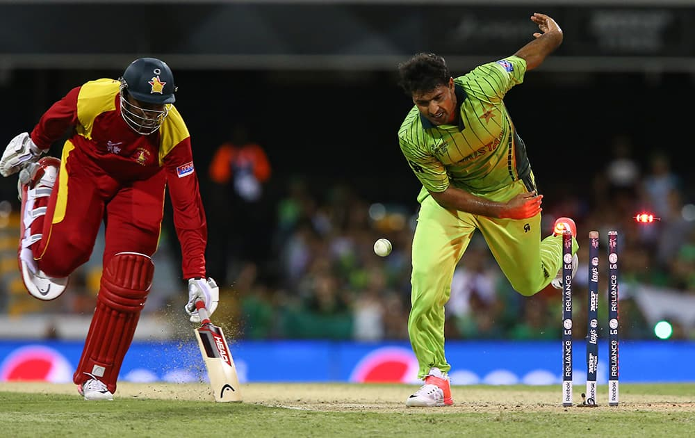 Zimbabwe's Tinashe Panyangara, left, successfully reaches the crease foiling a run out attempt by Pakistan's Sohail Khan during their Pool B Cricket World Cup match in Brisbane, Australia.