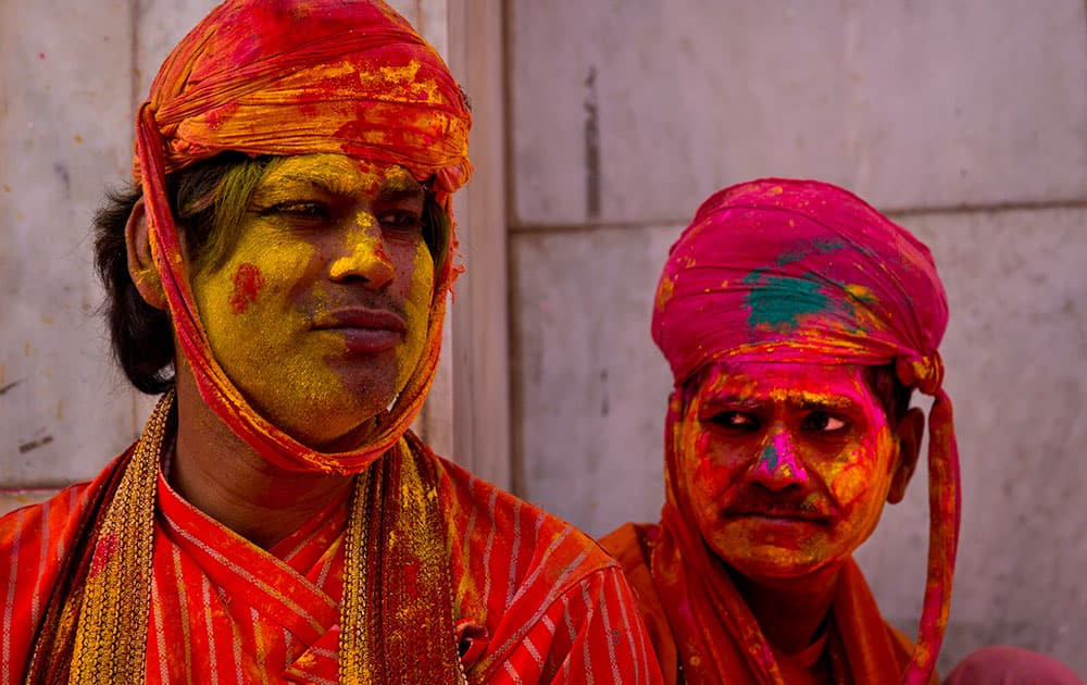 Villagers from Nandgaon wait for the arrival of villagers from Barsana at the Nandagram temple, famous for Lord Krishna and his brother Balram, during Lathmar holi festival, in Nandgaon.