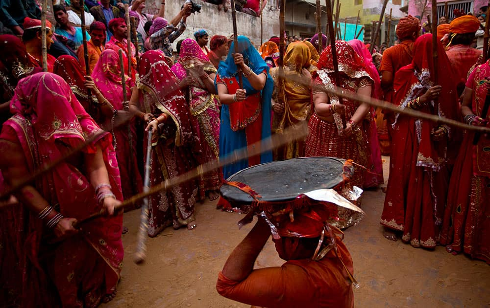 Women from Nandgaon village beat the shield of a man from Barsana during Lathmar festival celebrations in Nandgaon.