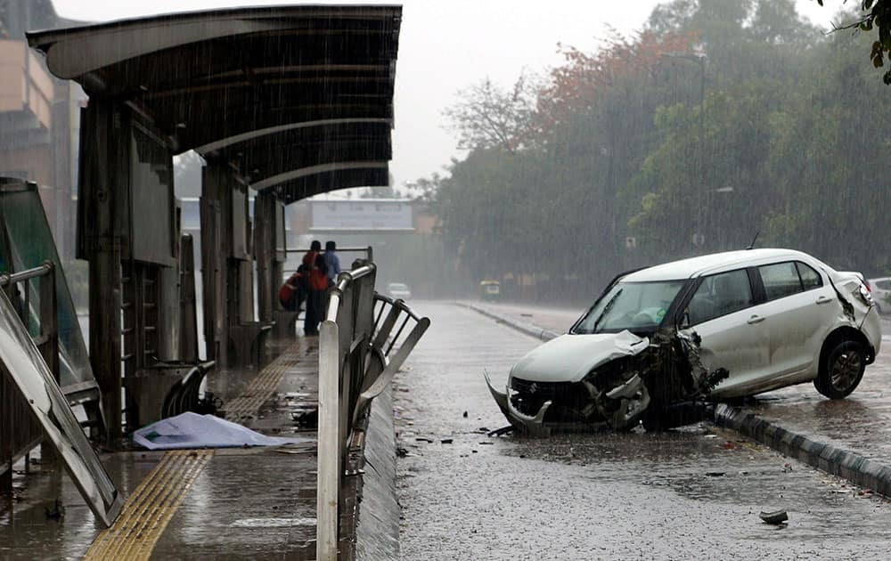 A car met with an accident during rains in New Delhi.