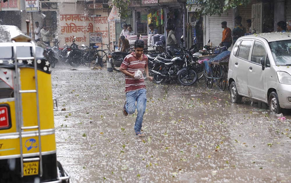 A road covered with hail storms as the city received heavy rainfall, in Jodhpur.