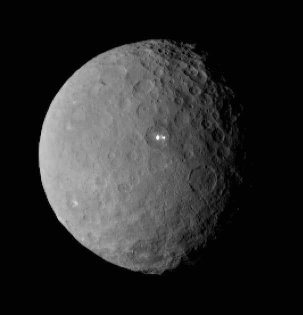 This image shows the swarf planet Ceres provided by NASA, taken by the agency's Dawn spacecraft from a distance of nearly 29,000 miles (46,000 kilometers). It shows that the brightest spot on Ceres has a dimmer companion, which apparently lies in the same basin, seen at center of the image.