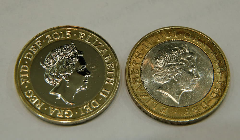 A new 2 pound coin (US$ 3.08), left is photographed next to a current 2 pound coin as a new portrait of Britain's Queen Elizabeth II is unveiled at the National Portrait Gallery in London. The image Britain's Queen Elizabeth II, the fifth of her reign was made by Jody Clark, at 33 the youngest designer. Portraits of the Queen were made in 1952,1968,1985,1998 and 2015, the image will appear on coins later this year.