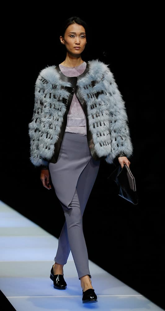 A model wears a creation for Giorgio Armani women's Fall-Winter 2015-16 collection, part of Milan Fashion Week.