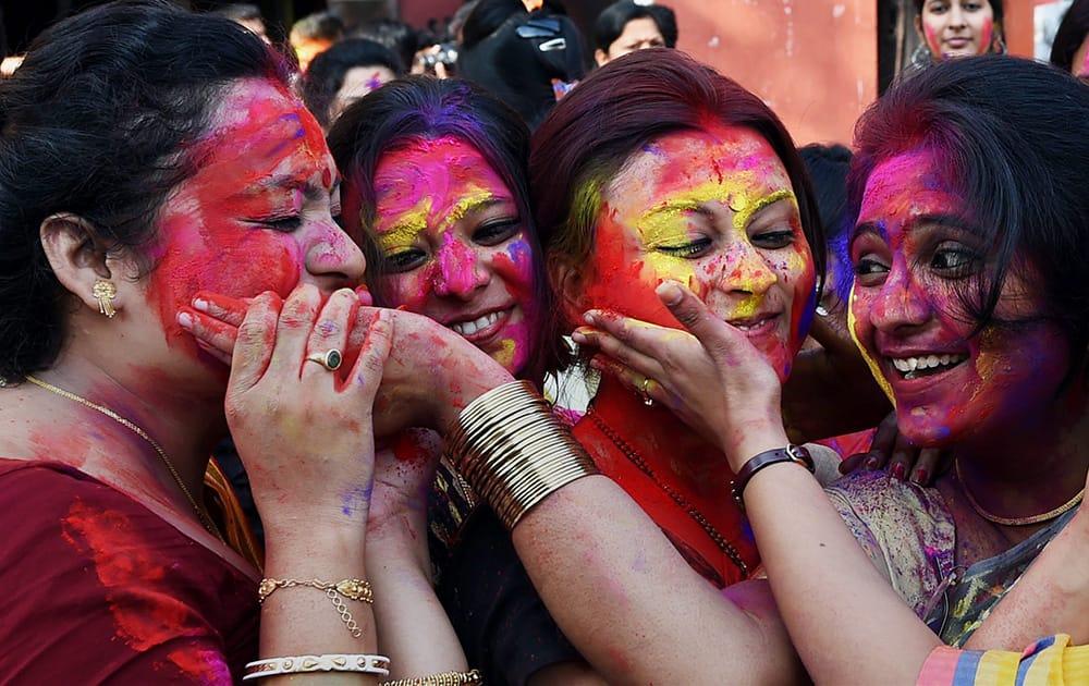 Students of Rabindra Bharati University celebrate Holi in Kolkata.