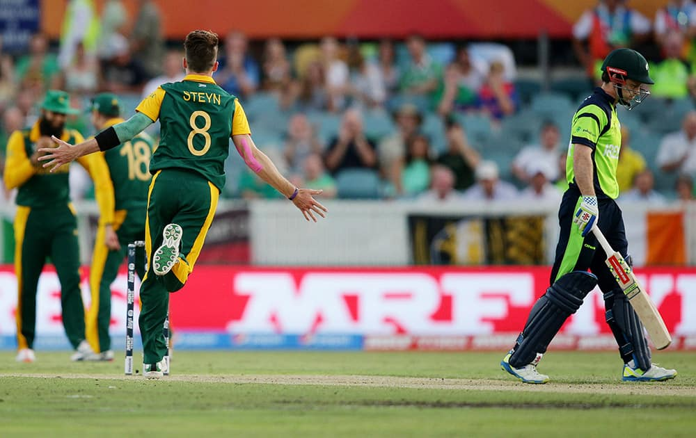 South Africa's Dale Steyn celebrates after taking the wicket of Ireland's Ed Joyce during their Cricket World Cup Pool B match in Canberra, Australia.