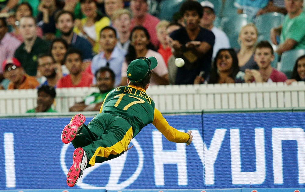 South Africa's AB De Villiers is airborne as he attempts to take a catch during their Cricket World Cup Pool B match against Ireland in Canberra, Australia.